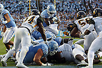 12 September 2015: UNC's Elijah Hood (34 in blue) scores a touchdown. The University of North Carolina Tar Heels hosted the North Carolina A&T State University Aggies at Kenan Memorial Stadium in Chapel Hill, North Carolina in a 2015 NCAA Division I College Football game.