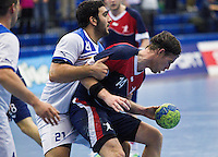 02 NOV 2011 - LONDON, GBR - Britain's Steve Larsson (#14 - blue and red) is held by Israel's Omer Jacob Davda (#21 - white) during the Men's 2013 World Handball Championship qualification match at the National Sports Centre at Crystal Palace .(PHOTO (C) NIGEL FARROW)