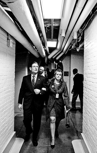 Rep.-elect Joe Heck, R-Nev., heads to the House floor with wife Lisa and their children for his swearing-in as a member of Congress on Wednesday, Jan. 5, 2011.
