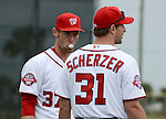 VIERA, FL-  FEBRUARY 26:  (L-R) Stephen Strasburg and Max Scherzer of the Washington Nationals relax before a bullpen session during the Washington Nationals Spring Training at Space Coast Stadium in Viera, FL (Photo by Donald Miralle) *** Local Caption ***