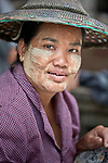 A woman in the Tahan Market in Kalay, a town in Myanmar. This market is located in Tahan, the largely ethnic Chin section of the town. The woman is wearing thanaka, a cosmetic paste, on her face.