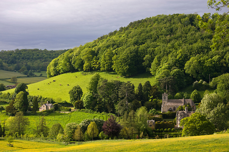 Typical idyllic countryside landscape rural scene in The Cotswolds Owlpen manor and Church, Gloucestershire, UK