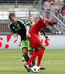 Nederland, Enschede, 29 april 2012.Eredivisie.Seizoen 2011-2012.FC Twente-Ajax.Theo Janssen (l.) van Ajax en Douglas van FC Twente (r.) van FC Twente strijden om de bal