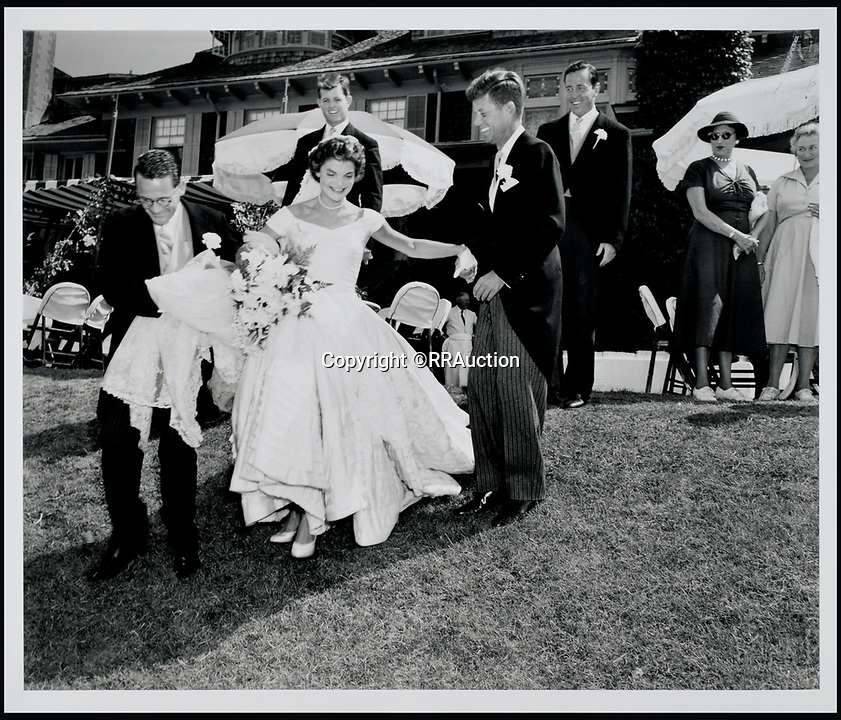 BNPS.co.uk (01202 558833)<br /> Pic: RRAuction/BNPS<br /> <br /> Jackie sliding down the hill after taking wedding party photos on the 300 acre ocean front estate Hammersmith Farm.<br /> <br /> Incredibly-rare photos highlighting the first foray into politics for John F. Kennedy that would eventually cost him his life have come to light.<br /> <br /> The 100 black and white snaps show a youthful-looking JFK from 1946, when he was campaigning to become a US congressman for the first time.<br /> <br /> The tragic future president is seen during an oration lesson where he was given help by an expert with public speaking and posture.<br /> <br /> The 29-year-old is also depicted mingling with the public at an annual parade and as well as celebrating his first political victory - a congressional primary vote - in June 1946.<br /> <br /> The images are being sold by US-based RR Auction.