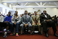 New York, USA. 23 August 2014. Esaw Garner wife of Eric Garner, (2nd L) and Rev. Al Sharpton (C ) attend a mass before a rally against police brutality in Staten Island.  Eduardo Munoz Alvarez/VIEWpress