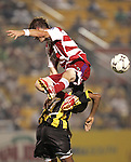 7 August 2007: FC Dallas's Drew Moor (14) is upended by Charleston's Andre Toussaint (7). FC Dallas of Major League Soccer defeated the Charleston Battery of the United Soccer League first division 2-1 after extra time in a quarterfinal match of the 2007 US Open Cup tournament at Blackbaud Stadium in Charleston, SC...