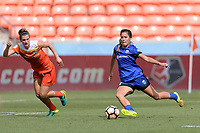 Houston, TX - Saturday May 27, 2017: Katie Johnson takes a shot at the goal and scores in front of Cari Roccaro (5) of the Houston Dash during a regular season National Women's Soccer League (NWSL) match between the Houston Dash and the Seattle Reign FC at BBVA Compass Stadium.