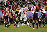 Chivas USA goalkeeper Brad Guzan (18) prepares to save a ball from attacking Real Salt Lake forward Atiba Harris (7) late in the second half. CD Chivas USA beat Real Salt Lake 1-0 in a MLS game at the Home Depot Center in Carson, California, Sunday, August 26, 2007.