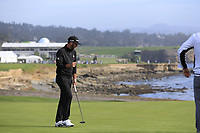 Dustin Johnson (USA) sinks his birdie putt on the 18th green during Saturday's Round 3 of the 2018 AT&amp;T Pebble Beach Pro-Am, held over 3 courses Pebble Beach, Spyglass Hill and Monterey, California, USA. 10th February 2018.<br /> Picture: Eoin Clarke | Golffile<br /> <br /> <br /> All photos usage must carry mandatory copyright credit (&copy; Golffile | Eoin Clarke)
