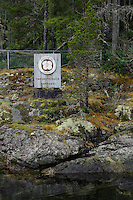 TA46840-D. Skookumchuck Narrows Provincial Park on the Sechelt Peninsula along the Sunshine Coast. One of the best scuba diving sites in British Columbia is right below this sign along a current-swept wall covered with sea anemones and sponges. Known as Sechelt Rapids, also called Skookumchuck Rapids, waters can rush at more than 16 knots, making these the fastest navigable waters in North America. To safely dive here requires careful planning and experience. British Columbia, Canada.<br /> Photo Copyright &copy; Brandon Cole. All rights reserved worldwide.  www.brandoncole.com