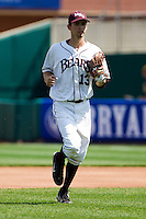 Kevin Medrano (13) of the Missouri State Bears runs into the dugout during a game against the Wichita State Shockers on April 9, 2011 at Hammons Field in Springfield, Missouri.  Photo By David Welker/Four Seam Images