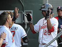 Outfielder Keury De la Cruz (25) of the Greenville Drive is congratulated after scoring a run in a game against the Charleston RiverDogs on May 31, 2012, at Fluor Field at the West End in Greenville, South Carolina. Charleston won, 13-2. (Tom Priddy/Four Seam Images)
