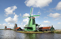 The Netherlands, Zaanse Schans, 2015 06 03. Mills in Zaanse Schans. The green mill is named Gekroonde Poelenburg