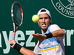 Juan Ignacio Chela of Argentina hits a forehand against Sam Querrey of the United States in the tennis finals of the U.S. Men's Clay Court Championship at River Oaks Country Club in Houston, Sunday, April 11, 2010. Chela  defeated Querrey for the singles title 5-7, 6-4, 6-3. (AP Photo/Steve Campbell)    .