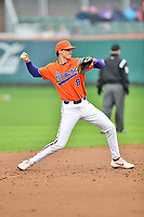 Clemson Tigers shortstop Logan Davidson (8) throws to first base between innings of a game against the North Carolina Tar Heels at Doug Kingsmore Stadium on March 9, 2019 in Clemson, South Carolina. The Tigers defeated the Tar Heels 3-2 in game one of a double header. (Tony Farlow/Four Seam Images)