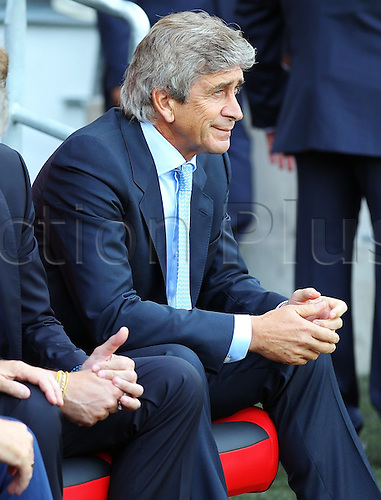 25.08.2013 Cardiff, Wales. Manchester City Manager Manuel Pellegrini looks pensive during the Premier League fixture between Cardiff City and Manchester City from the Cardiff City Stadium.