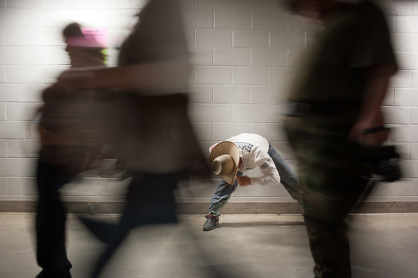 Bareback rider J.R. Vezain warms up before competing at the College National Finals Rodeo in Casper, Wyo. Unlike college athletes in other sports, student rodeo atheletes are allowed to compete for money and sign with sponsors. (Kevin Moloney for the New York Times)