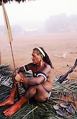 A-Ukre village, Brazil. Chief Mote  preparing himself for the hunt in the early morning; Xingu Indigenous Area, Para State.