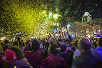 Sixth Street Celebration as party goers watch the New Year Countdown and confetti streamers drop on the 6th Street Bar District in Austin, Texas.