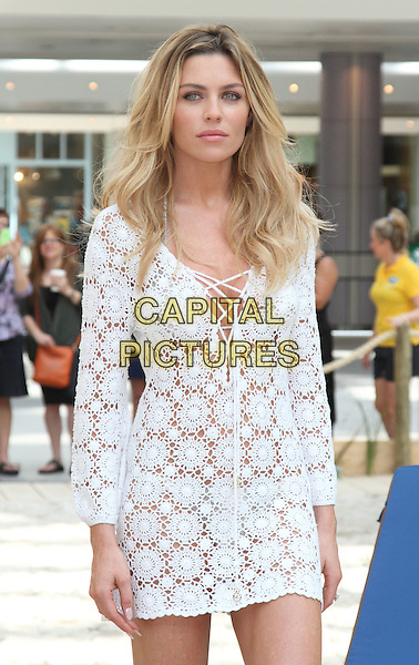 LONDON, ENGLAND - JULY 18: Abbey Clancy attends a photocall to launch the Scholl Pop Up Pedicure Beach at Westfield on July 18, 2014 in London, England<br /> CAP/JIL<br /> &copy;Jill Mayhew/Capital Pictures