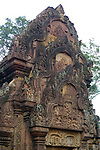 Angkorian temple Banteay Srei (late 10th century) 967.<br /> North library pediment shows Krishna killing Kamsa.<br /> Three sanctuary towers.The central sanctuary and the southern sanctuary were dedicated to Shiva and the northern sanctuary was dedicated to Vishnu.<br /> Banteay Srei temple is situated 20km north of Angkor, built during the reign of Rajendravarman by Yajnavaraha, one of his counsellors. In antiquity Isvarapura was a small city that grew up around the temple. Banteay Srei was dedicated to the worship of Shiva, the foundation stele describes the consecration of the linga Tribhuvanamahesvara (Lord of the three worlds) in 967.