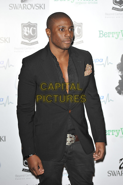 Leo Ihenacho.'Global Angels Awards', The Park Plaza Hotel, Westminster, London, England. 2nd December 2011..half length black jacket shirt undone chest .CAP/MAR.© Martin Harris/Capital Pictures.