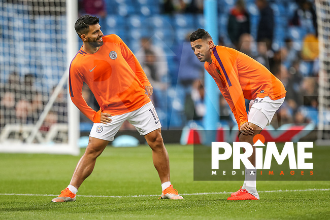 Sergio AGUERO of Manchester City and Riyad MAHREZ of Manchester City warm up during the UEFA Champions League match between Manchester City and Olympique Lyonnais at the Etihad Stadium, Manchester, England on 19 September 2018. Photo by David Horn / PRiME Media Images.