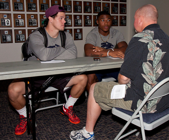 Kendall Brock and Don Jackson talk with RGJ reporter Dan Hinxman during the Nevada Wolf Pack Football Media Day at Legacy Hall on the University of Nevada campus Sunday, August 11, 2013.
