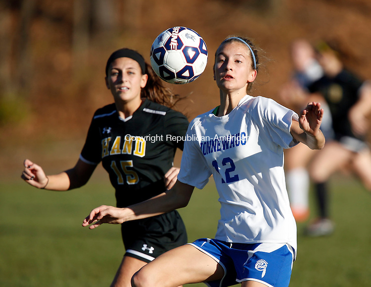 WOODBURY, CT- 13 November 2016-111316CM03- Nonnewaug's Mary Bibbey right, moves in for the ball against Hand's Samantha Mayhew during their state tournament matchup in Woodbury on Sunday.   Christopher Massa Republican-American Nonnewaug would be eliminated from the tournament after losing 2-0.