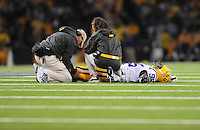 Sept. 5, 2009; Seattle, WA, USA; LSU Tigers defensive end Lazarius Levingston is tended to by trainers after getting injured against the Washington Huskies at Husky Stadium. LSU defeated Washington 31-23. Mandatory Credit: Mark J. Rebilas-