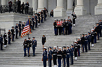 The flag-draped casket of former President George H.W. Bush is carried by a joint services military honor guard from the U.S. Capitol, Wednesday, Dec. 5, 2018, in Washington. <br /> CAP/MPI/RS<br /> &copy;RS/MPI/Capital Pictures
