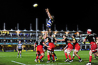 Charlie Ewels of Bath Rugby rises high to win lineout ball. Aviva Premiership match, between Bath Rugby and Saracens on April 1, 2016 at the Recreation Ground in Bath, England. Photo by: Patrick Khachfe / Onside Images