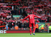 7th March 2020; Anfield, Liverpool, Merseyside, England; English Premier League Football, Liverpool versus AFC Bournemouth; Mohammed Salah of Liverpool looks on as fans raise their scarves and sing You'll Never Walk Alone prior to the kick off