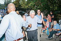 Democratic presidential candidate Bernie Sanders greets people as he marches in the Labor Day parade in Milford, New Hampshire.  Republican candidates John Kasich, Carly Fiorina, and Lindsey Graham also marched in the parade.