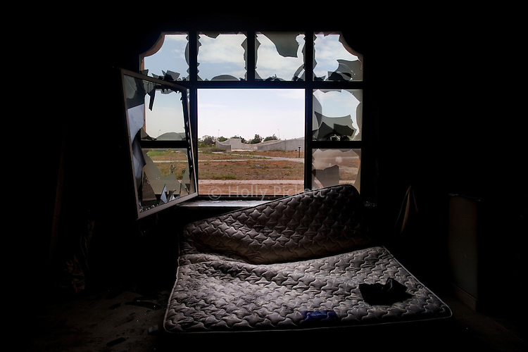 A bedroom in a bombed and looted Gaddafi family palace in Sirte, Libya, Oct. 10, 2011.