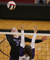 Arkansas Democrat-Gazette/STATON BREIDENTHAL --10/29/19-- Mount St. Mary Academy's Millie Allgoood (left) hits the ball   as Fayetteville's Amelia Whatley defends Tuesday during their game in the 6A state Volleyball Tournament in Cabot. See more photos at arkansasonline.com/1030volleyball6A/.