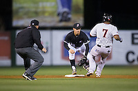 Kannapolis Intimidators second baseman Daniel Mendick (22) prepares to put the tag on Andy Ibanez (7) of the Hickory Crawdads as umpire Ryan Powers looks on at Kannapolis Intimidators Stadium on April 8, 2016 in Kannapolis, North Carolina.  The Crawdads defeated the Intimidators 8-2.  (Brian Westerholt/Four Seam Images)