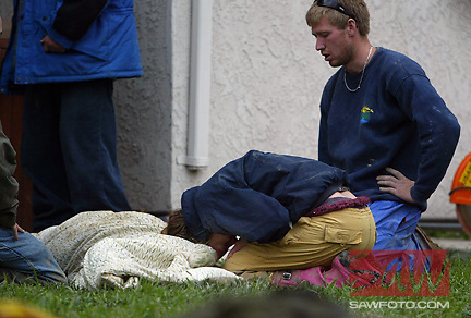 Digital Image taken on Tuesday, 01/11/2005, La Conchita, CA - Grieving for a lost life, La Conchita residents mourn over body recovered Tuesday, one of two children that were missing since Monday's devastating landslide in La Conchita, south of Santa Barbara that destroyed 15 houses and killed 4+ people.