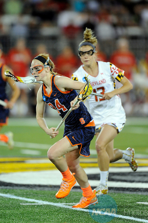 25 MAY 2014:  Bridget Daley (24) of the Syracuse Orange handles the ball against the Maryland Terrapins during the Division I Women's Lacrosse Championship held at Unitas Stadium in Towson, MD.  Maryland defeated Syracuse 15-12 for the national title.  Greg Fiume/NCAA Photos