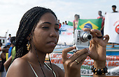 "Altamira, Brazil. ""Xingu Vivo Para Sempre"" protest meeting about the proposed Belo Monte hydroeletric dam and other dams on the Xingu river and its tributaries. Woman holding a digital camera."