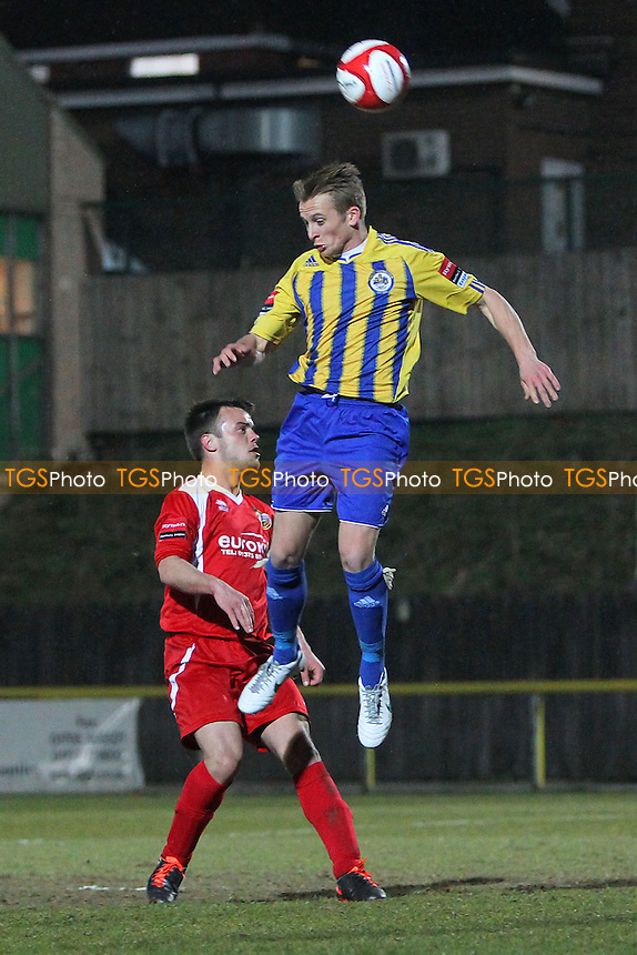 Ben Jones of Romford rises above Jack Carlisle of Tilbury - Romford vs Tilbury - Ryman League Division One North Football at Ship Lane, Thurrock FC - 10/04/13 - MANDATORY CREDIT: Gavin Ellis/TGSPHOTO - Self billing applies where appropriate - 0845 094 6026 - contact@tgsphoto.co.uk - NO UNPAID USE.