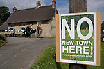 Residents display protest  signs  against the  Weston On Otmoor eco town.countering the Parkridge developments Eco town proposals. The proposed 15,000-home development ecotown at Weston-on-the-Green, near Oxford, the campaigners claim is an eco scam creating massive gated community and introducing  too many cars to be sustainably managed in the area  .