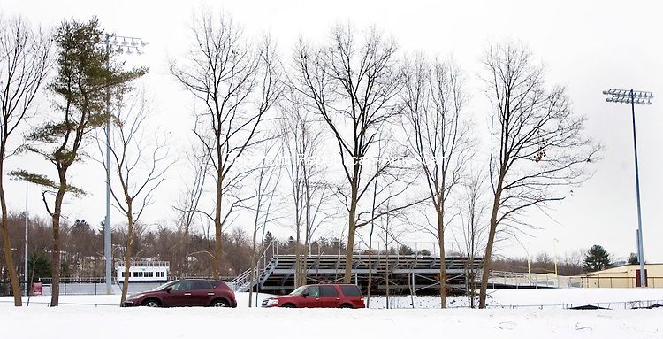 TORRINGTON CT. 26 January 2014-012615SV06-Cars on Route 8 north zip by the football field at the High School in Torrington Monday. A turf committee is looking to raise $5,000 to help pay for the netting to string across what was once the tree line at Torrington High School's athletic field. <br /> Steven Valenti Republican-American
