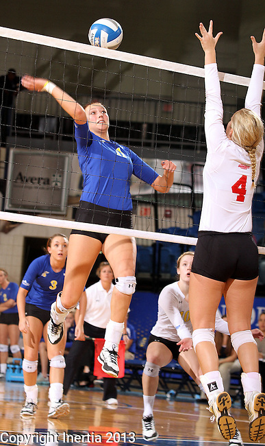 BROOKINGS, SD - OCTOBER 5:  Wagner Larson #11 from South Dakota State University winds up for a kill attempt past Audrey Reeg #4 from the University of South Dakota in the fourth game of their match Saturday night at Frost Arena. (Photo by Dave Eggen/Inertia)