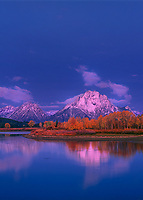 749450001av dawn light on the teton range at the oxbow bend of the snake river on an autumn morning with fall colored aspens in grand tetons national park wyoming