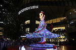 "April 26, 2018, Tokyo, Japan - A 4-meter tall statue ""Flora"", produced by Japanese contemporary artist Kenji Yanobe stands and illuminates its dress at the opening of Hibiya Festival to celebrate for the opening of Tokyo's new landmark Tokyo Midtown Hibiya on Thursday, April 26, 2018. ""Flora"" is installed at the forecourt of the shoppoing mall through May 20.   (Photo by Yoshio Tsunoda/AFLO) LWX -ytd-"