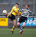 Montrose's Paul Lunan and Shire's Paul Quinn challenge for the ball.