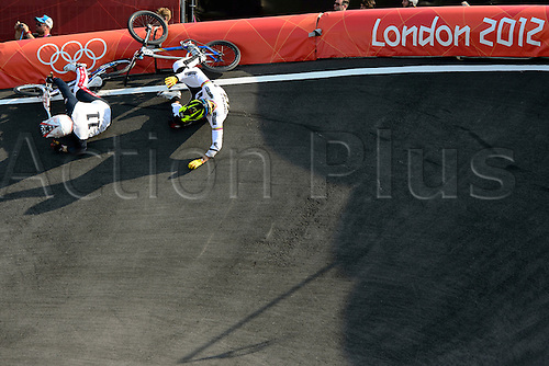 10.08.2012 London, England. Connor Fields (USA) and Ae Jimenez Caicedo (COL) crash on the last bend in the Mens BMX racing Final on Day 14 of the London 2012 Olympic Games on the BMX track at the Velodrome on the Olympic Park.