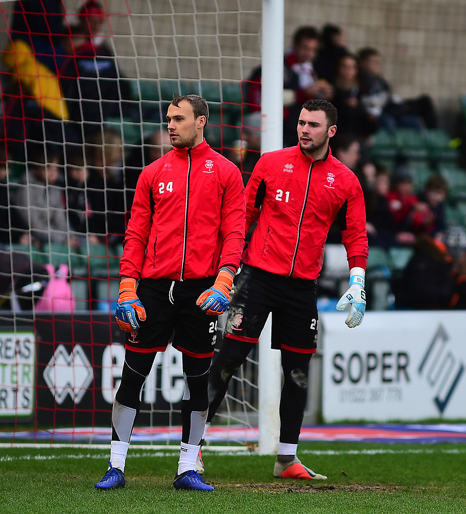 Lincoln City's Sam Slocombe, left, and Grant Smith during the pre-match warm-up<br /> <br /> Photographer Andrew Vaughan/CameraSport<br /> <br /> The EFL Sky Bet League Two - Lincoln City v Newport County - Saturday 22nd December 201 - Sincil Bank - Lincoln<br /> <br /> World Copyright © 2018 CameraSport. All rights reserved. 43 Linden Ave. Countesthorpe. Leicester. England. LE8 5PG - Tel: +44 (0) 116 277 4147 - admin@camerasport.com - www.camerasport.com
