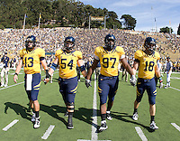 California starting captains, Kevin Riley, Chris Guarnero, Cameron Jordan and Mike Mohamed walk on the field for a coin toss before the game against UCLA at Memorial Stadium in Berkeley, California on October 9th, 2010.   California defeated UCLA, 35-7.